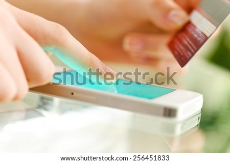 Woman is shopping online with cell phone. - stock photo