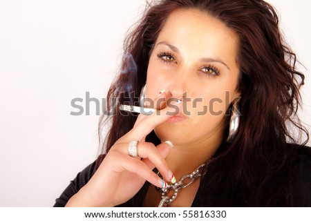 Woman is smoking a cigarette - stock photo