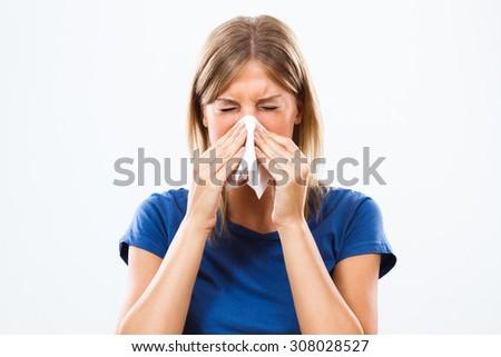 Woman is sneezing into handkerchief.Woman having flu - stock photo
