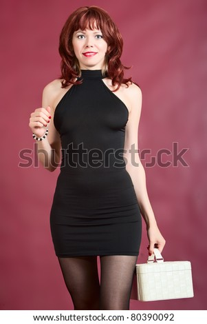 woman is standing with leather case - stock photo