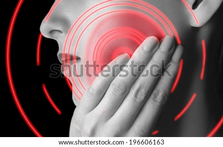 Woman is touching her cheek, toothache, black and white image, pain area of red color - stock photo