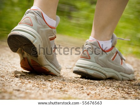 Woman jogging on parkway path - stock photo
