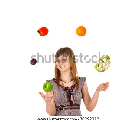 Woman juggling with fruits and vegetables. Isolated on white background - stock photo