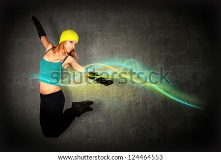 Woman jumping/dancing with glowing lines around her - stock photo