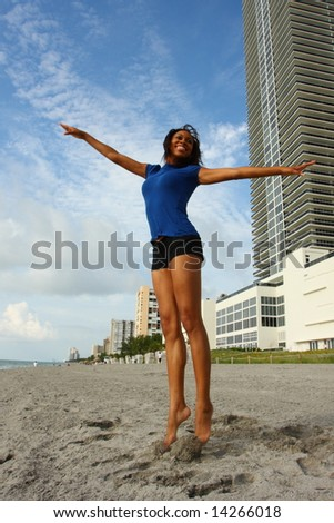 Woman Jumping For Joy - stock photo