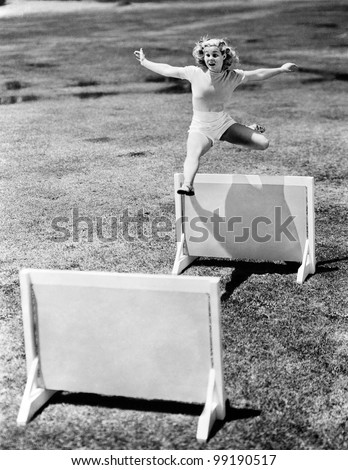 Woman jumping hurdles labeled with years - stock photo