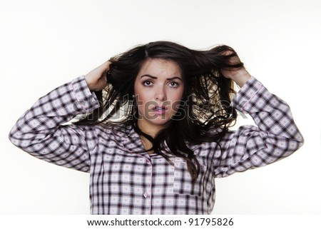 woman just got up wearing pajamas having a bad hair day - stock photo