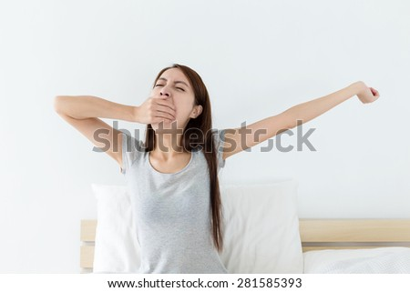 Woman just wake up at bedroom - stock photo