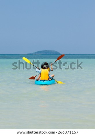 woman kayaking in sea - stock photo