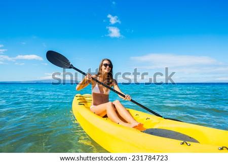 Woman Kayaking in the Ocean - stock photo