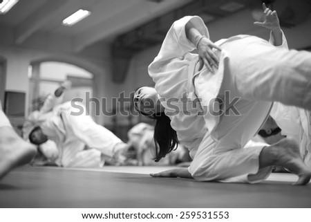 Woman keeping balance at martial arts training - stock photo