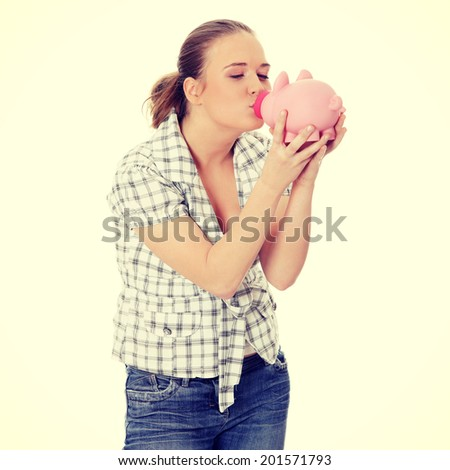 Woman Kissing her  Piggy Bank - stock photo