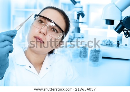 woman laboratory assistant in the laboratory of food quality - stock photo