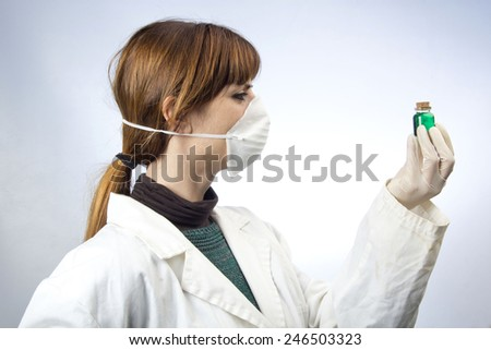 Woman laboratory medicine bottle - stock photo