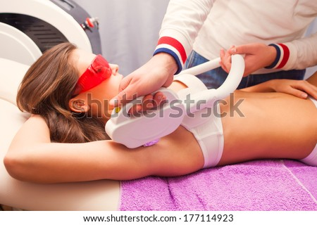 woman laser epilation armpit  - stock photo