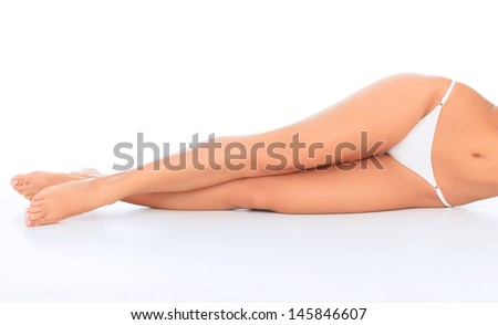 Woman laying on the white floor. Copyspace.  - stock photo
