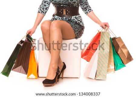 Woman legs in highheels with many shopping bags isolated on white background. Shopping concept. - stock photo