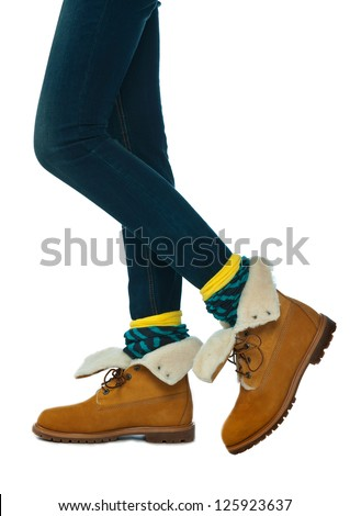 woman legs in shoes and stripes socks - stock photo