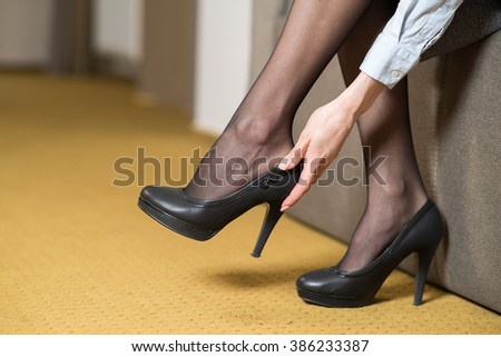 Woman legs in tights and shoes - stock photo