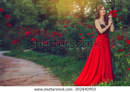 Woman like a princess in an vintage red dress - stock photo