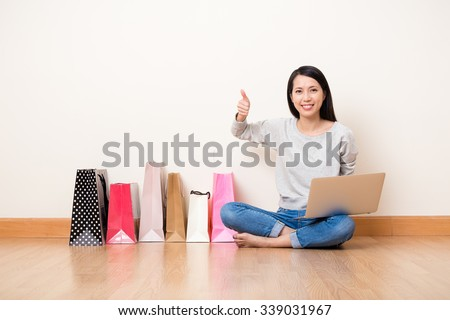 Woman like online shopping though laptop computer - stock photo
