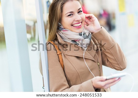 Woman listening to music with smartphone  - stock photo