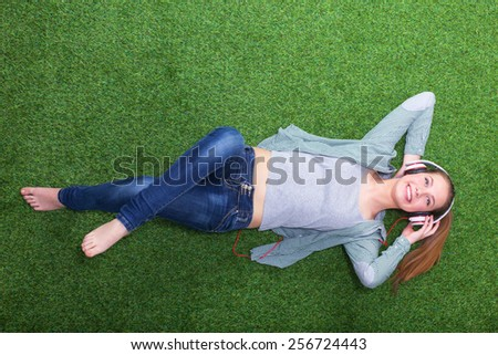 Woman listening to the music. - stock photo
