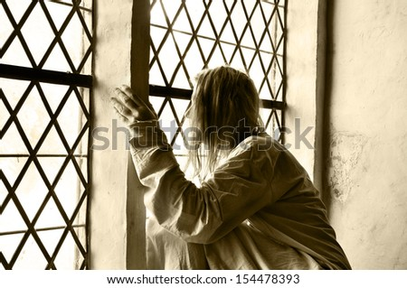 Woman locked up at a psychiatric ward - stock photo