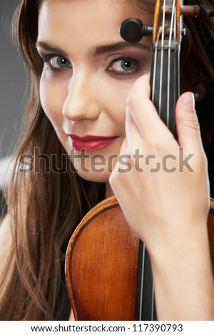 Woman long hair portrait isolated on gray background. Music violin. Female face close up. - stock photo