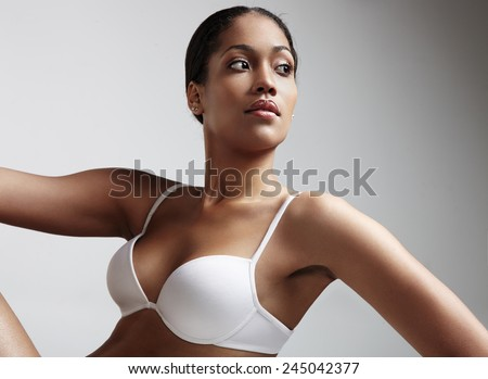 woman looking aside and wearing white bra - stock photo