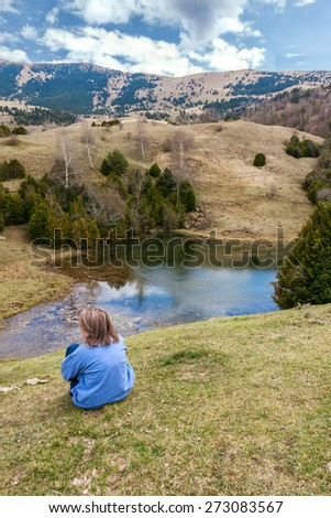 Woman looking at a beautiful landscape in the Catalan Pyrenees - stock photo