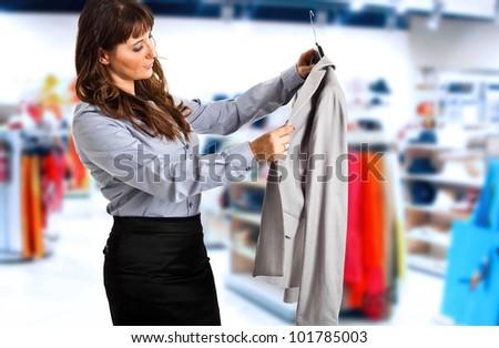 Woman looking at a dress - stock photo