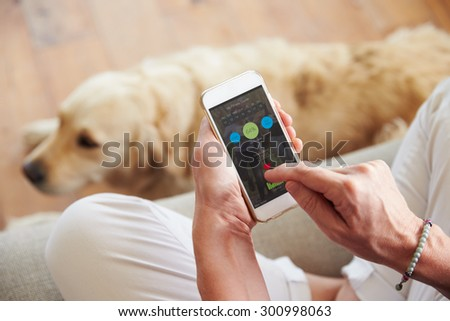Woman Looking At Health Monitoring App On Smartphone - stock photo