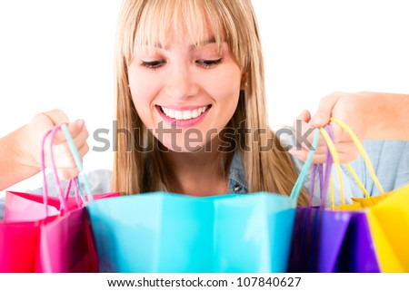 Woman looking at her purchases - isolated over a white background - stock photo