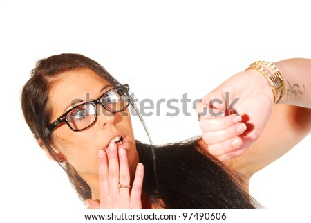 Woman looking at her watch - stock photo