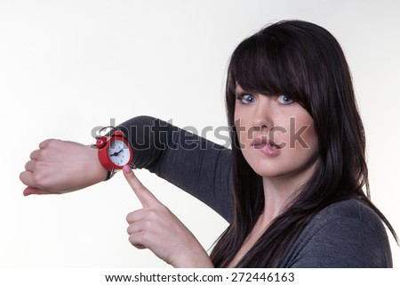 woman looking at here wrist watch late for a something - stock photo