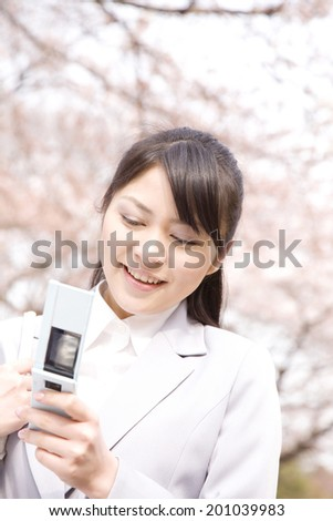 Woman looking at the mobile phone - stock photo