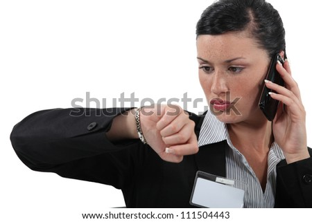 Woman looking at the time - stock photo
