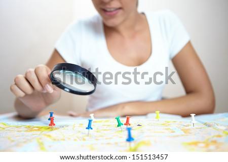 woman  looking at world map  - stock photo