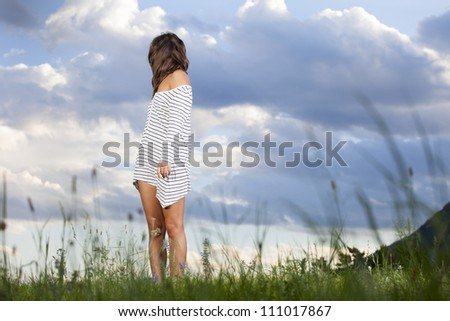 woman looking back over her shoulder - stock photo