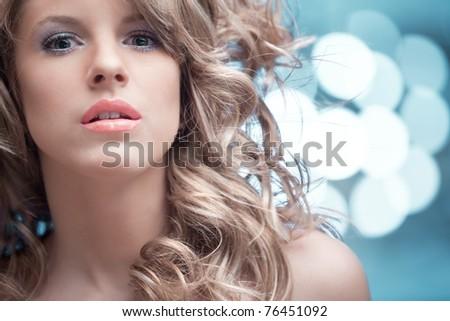 woman looking blue glitter - stock photo