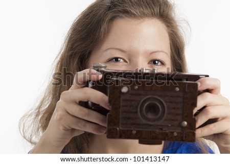 Woman looking over a camera - stock photo