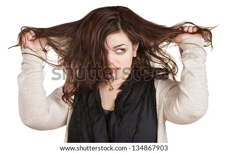 Woman looking over while pulling messy hair - stock photo