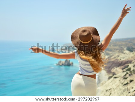 Woman looking to the sea near Aphrodite birthplace on Cyprus back view - stock photo