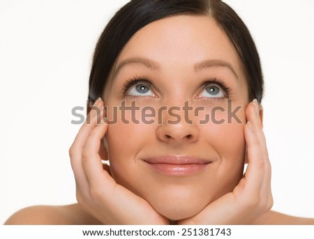 Woman  looking up hands face with beautiful healthy skin  - stock photo