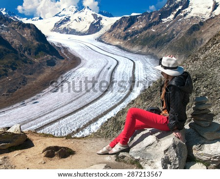woman looks at ice aletsch - stock photo