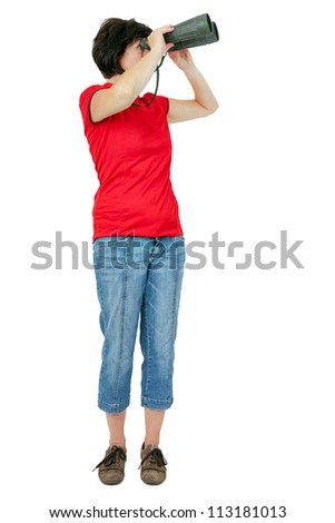 Woman looks through binoculars - stock photo