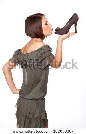 woman loves her shoes - stock photo