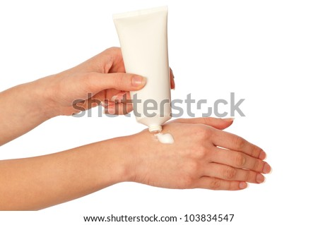 woman lubricates the hands skin with cosmetic cream - stock photo