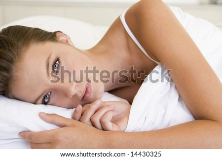 Woman lying in bed - stock photo